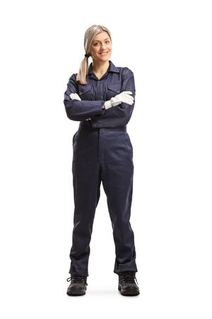 Full length portrait of a female worker in an overall uniform isolated on white background