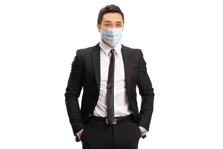 Young businessman wearing a protective medical face mask isolated on white background