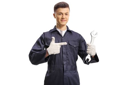 Young guy worker holding a wrench isolated on white background