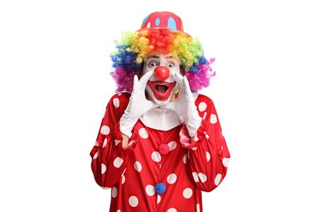Clown in a polka dot red costume shouting isolated on white background