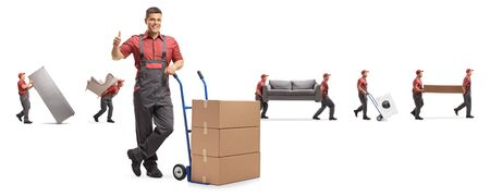 Worker in a uniform with a hand truck showing thumbs up and other worekrs from a removal company behind isolated on white background