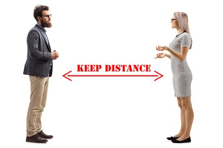 Full length profile shot of a man and woman talking and an arrow drawn between them with message keep distance isolated on white background