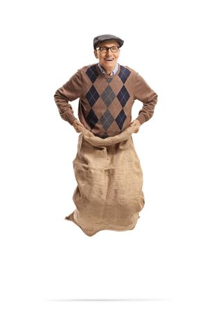 Happy elderly man jumping inside a sack isolated on white background