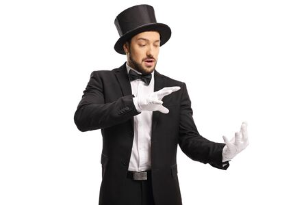 Magician wearing white gloves and performing a trick with his hands isolated on white background