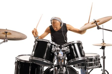 Man with headphones playing a drum set isolated on white background