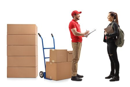 Full length shot of a delivery man delivering boxes to a female student isolated on white background Stockfoto