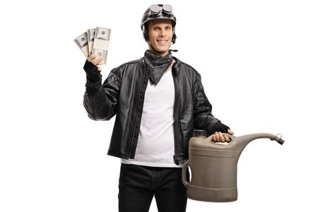 Young biker holding a gas container and money isolated on white background