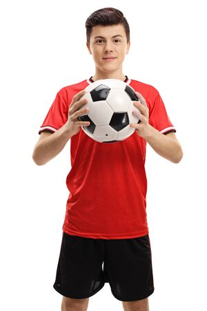 Male teenager holding a soccer ball isolated on white background