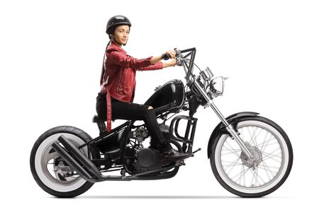 Female biker with a helmet and a leather jacket riding a chopper motorbike isolated on white background