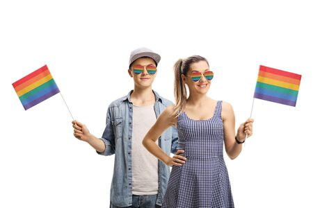 Young man and woman activists wearing rainbow sunglasses and waving a rainbow flags isolated on white background