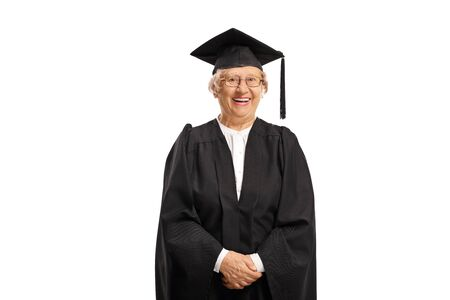 Elderly female graduate wearing a gown and smiling isolated on white background Reklamní fotografie