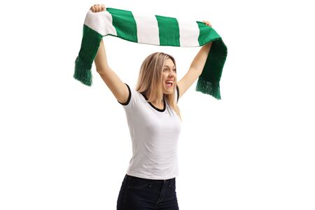 Young woman cheering with a green and white scarf isolated on white background
