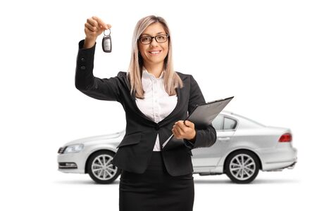 Businesswoman with a silver car holding a key isolated on white background Stock fotó