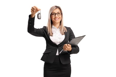 Young professional woman showing a car key isolated on white background Banque d'images