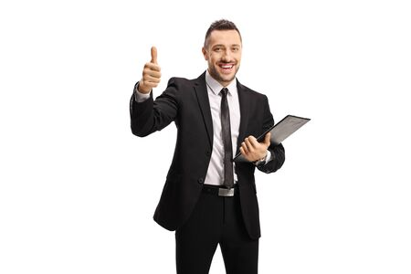 Businessman with a clipboard and documents showing thumbs up isolated on white background
