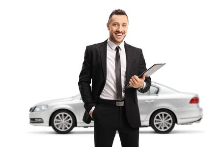 Silver car and a man in a black suit posing isolated on white background