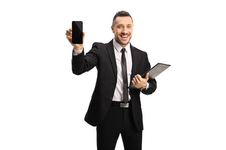 Businessman with documents showing a mobile phone isolated on white background