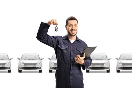Auto mechanic with many cars holding key isolated on white background Foto de archivo