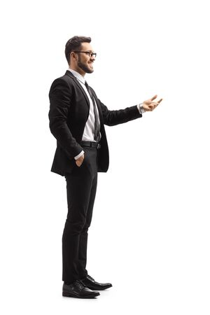 Full length shot of a businessman gesturing with a hand isolated on white background