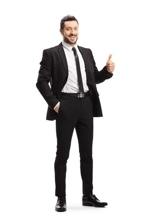 Full length portrait of a businessman showing thumbs up isolated on white background 免版税图像