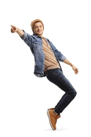 Guy in casual wear dancing and pointing isolated on white background