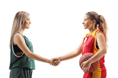 Female basketball players shaking hands isolated on white background