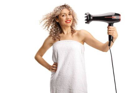 Young woman in a white towel drying hair with a diffuser for curly hair isolated on white background