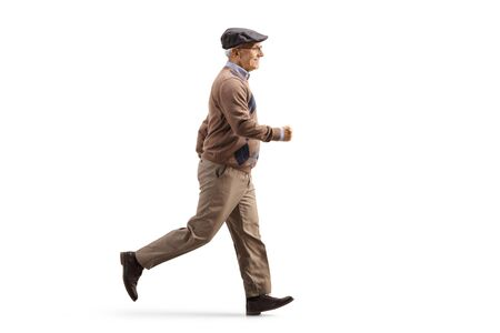 Full length profile shot of an elderly man in casual clothes running isolated on white background