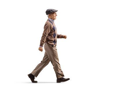 Full length profile shot of an elderly man walking fast isolated on white background