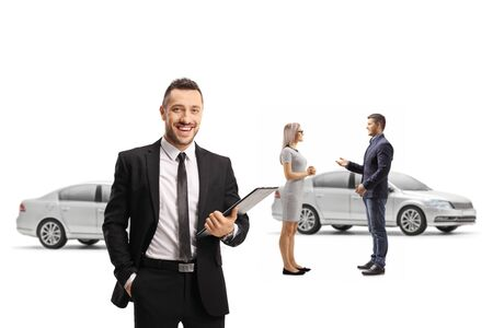 Manager in a car showroom and a man and woman customers talking isolated on white background Foto de archivo