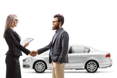 Businesswoman shaking hands with a man buying a car isolated on white background