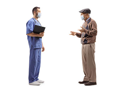 Full length profile shot of a medical worker with a mask talking to an elderly man isolated on white background Imagens