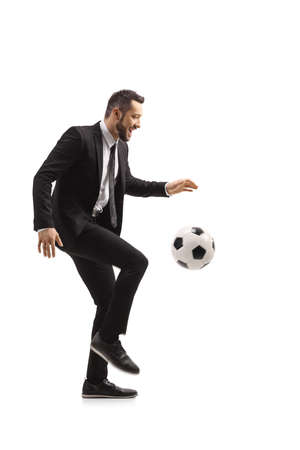 Full length portrait of a man in a black suit holding a football and showing thumbs up isolated on white background