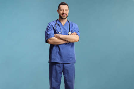 Full length profile shot of a doctor in a blue uniform isolated on blue background