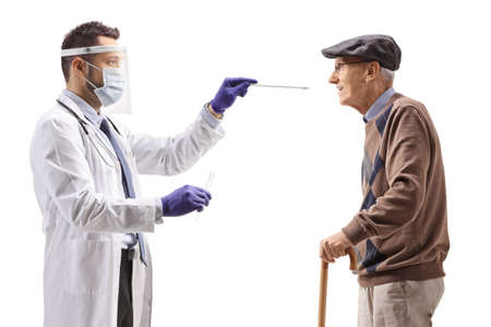 Doctor with protective equipment taking a cotton swab test from an elderly man isolated on white background