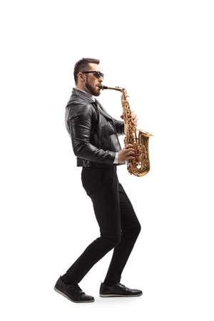 Full length profile shot of man playing a saxophone musical instrument isolated on white background