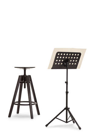 Studio shot of a black chair and a music notebook on a stand isolated on white background