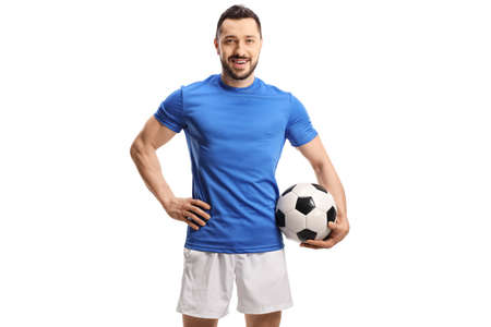Soccer player in a blue jersey holding a football isolated on white background