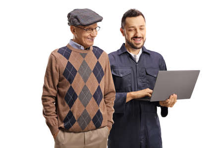 Man in a unoform showing a laptop computer to an elderly man isolated on white background Standard-Bild
