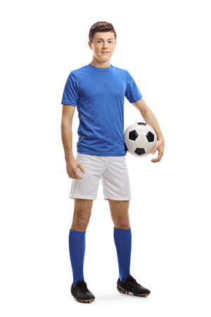 Full length portrait of a teenager soccer player with a ball under arm isolated on white background