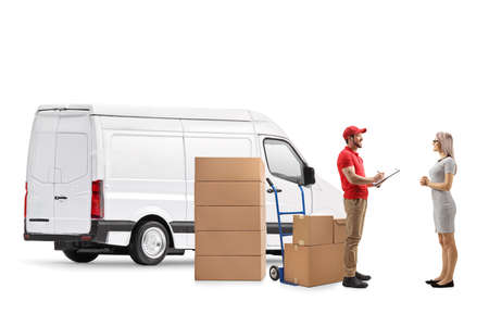 Delivery man with a van delivering boxes to a young woman isolated on white background Stockfoto