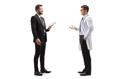 Full length profile shot of professional man in a suit talking to a male doctor isolated on white background