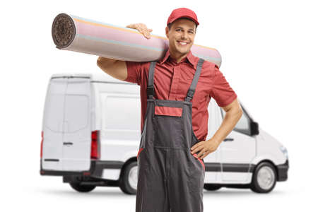 Worker from a carpet cleaning company with a van isolated on white background Stockfoto