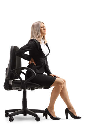 Young woman at work with a painful lower back sitting on a chair isolated on white background