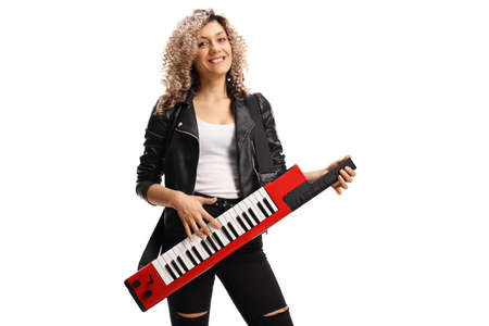 Female musician with a curly blond hair playing a keytar synthesizer isolated on white background