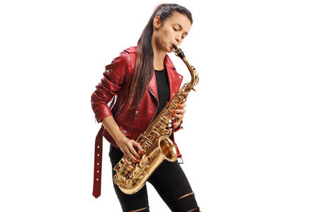 Young female saxophonist in a red leather jacket playing jazz music isolated on white background