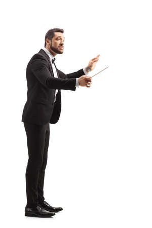 Full length profile shot of a music conductor directing a performance isolated on white background