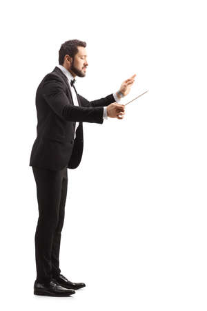 Full length profile shot of a young music conductor directing isolated on white background