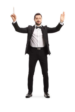 Full length portrait of a male musical conductor starting a show isolated on white background