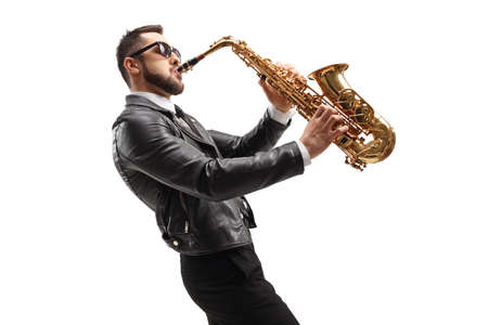 Side shot of male musician in a leather jacket playing a saxophone isolated on white background